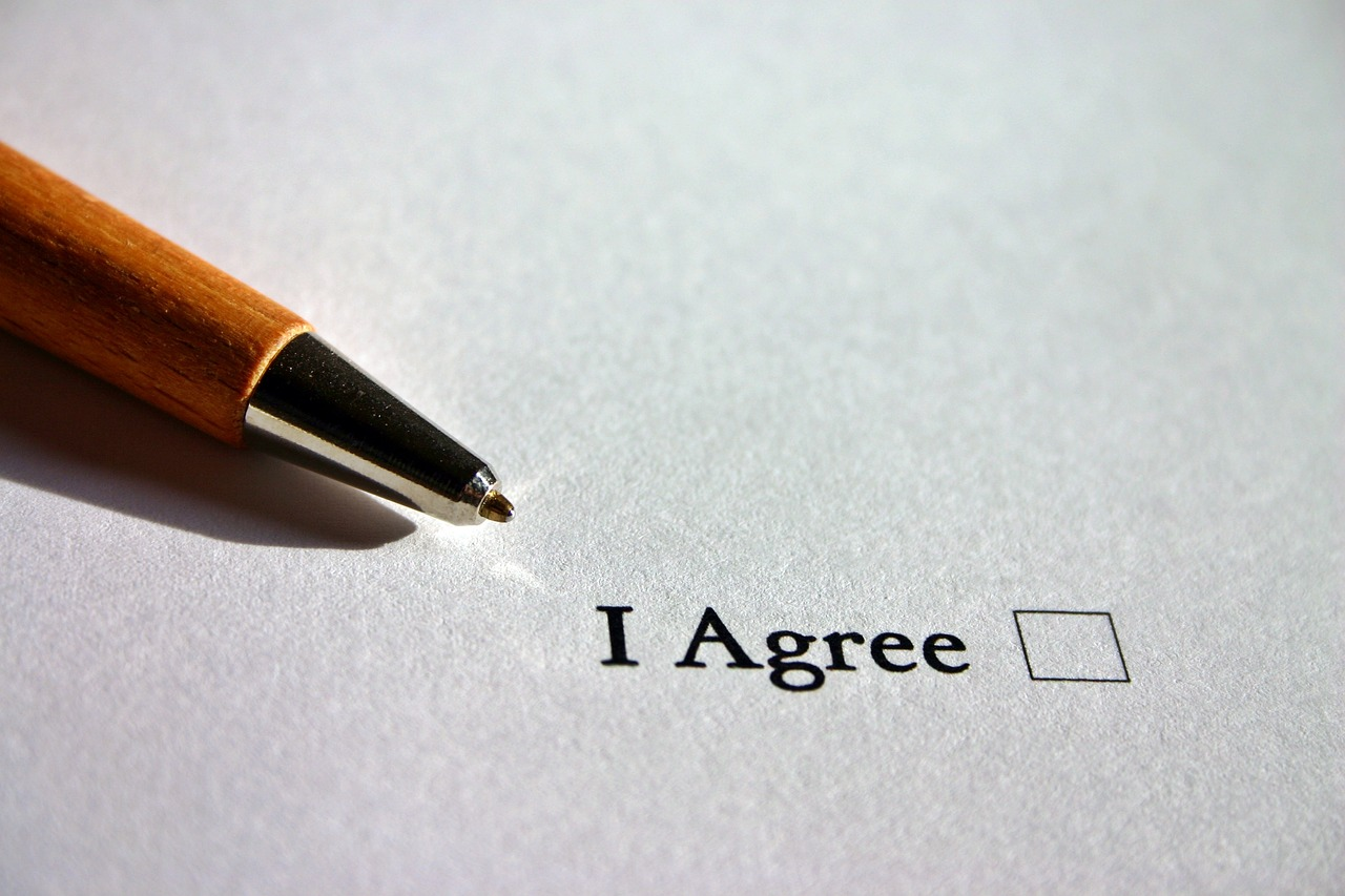 """A contract that reads, """"I Agree""""."""