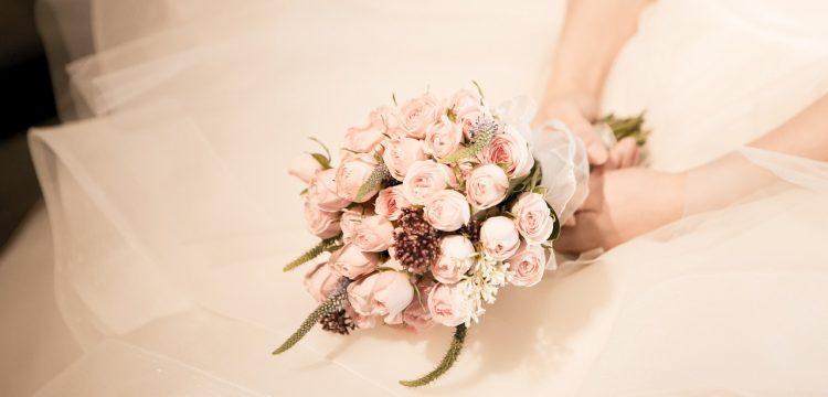 Bride holding flowers.
