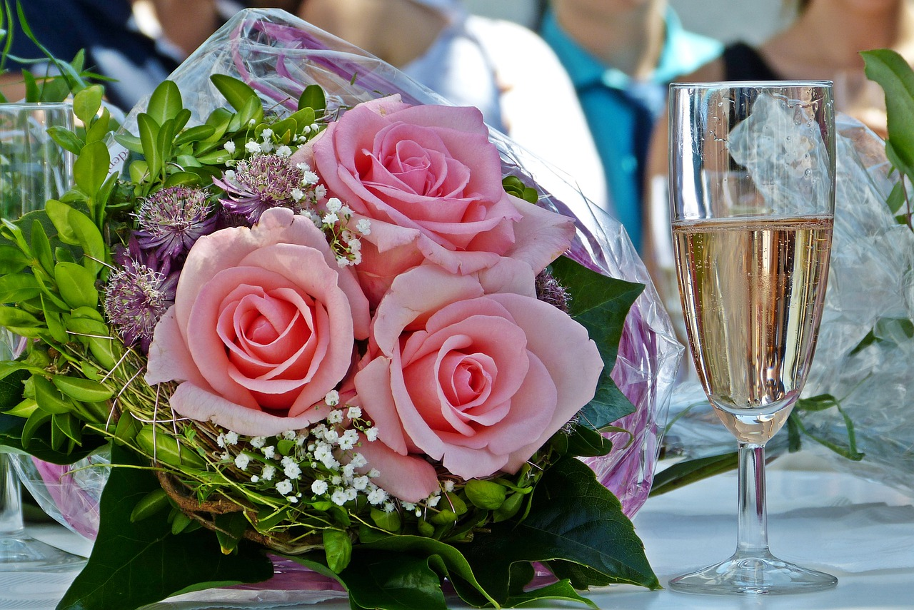 Wedding bouquet and a glass of champagne.