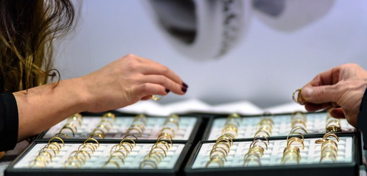 Woman picking out a wedding ring.