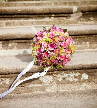 Wedding bouquet on outdoor steps.