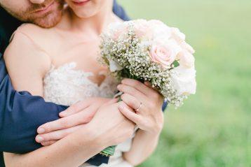 Groom hugging bride.