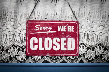 Closed sign on a window.