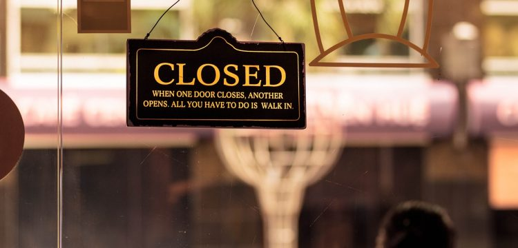 """A """"closed"""" sign on a door."""