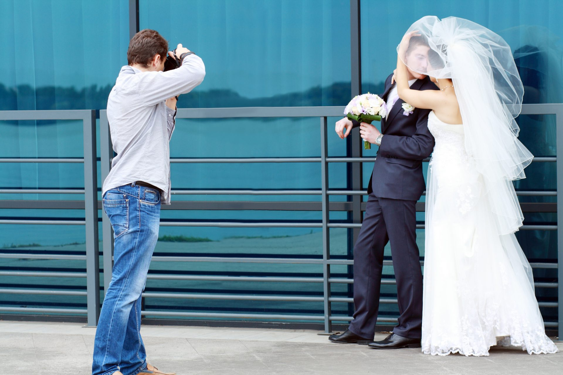 Photographer taking a picture of a wedded couple.