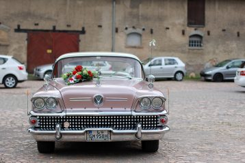 50s car with a bride's bouquet resting on top.