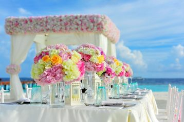 A fancy reception table for a beach wedding.