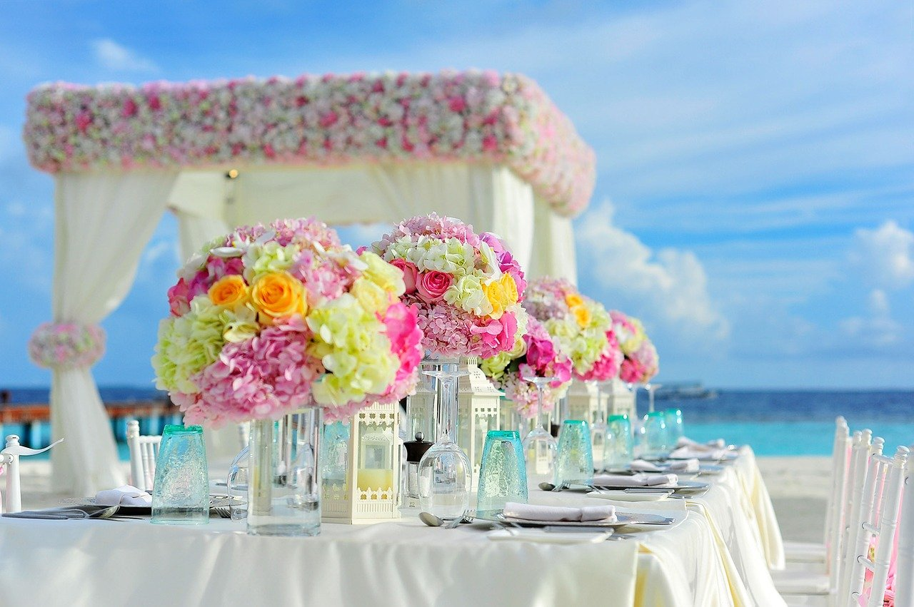 A fancy reception table for a beach wedding.