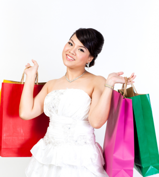 Bride holding shopping bags.
