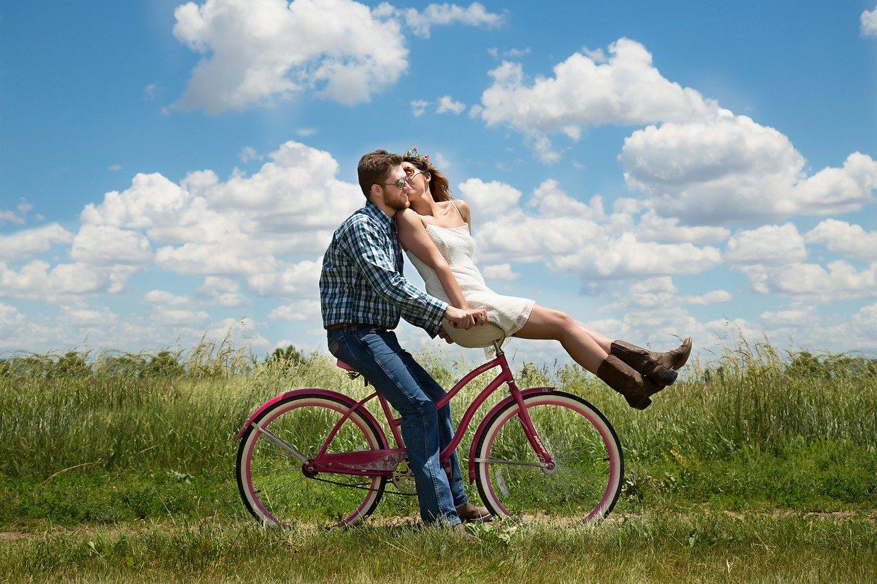 Couple riding a bike together.