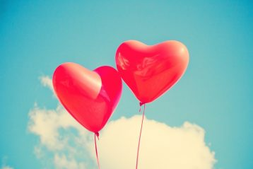 Two heart-shaped balloons.