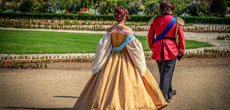 A prince and princess walking.