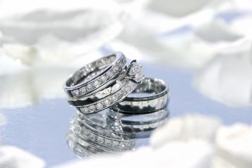 Engagement and wedding rings.