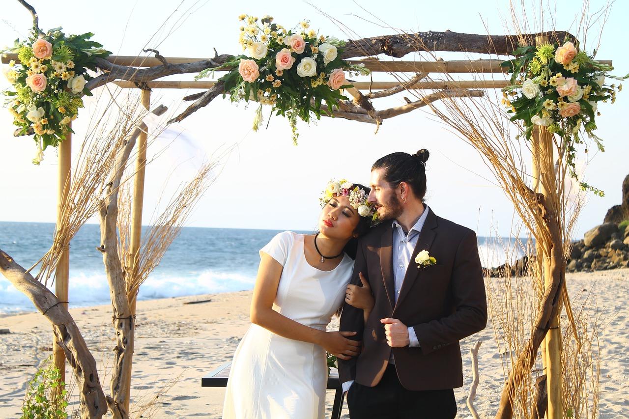 Couple at a beach wedding.