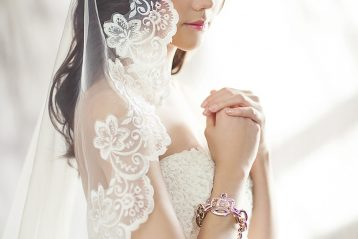 Bride with lacy veil.
