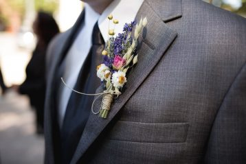 A groom wearing a bouttoniere.