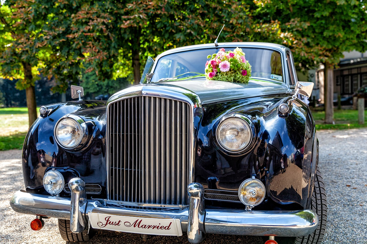 A retro car with a Just Married sign on the front.