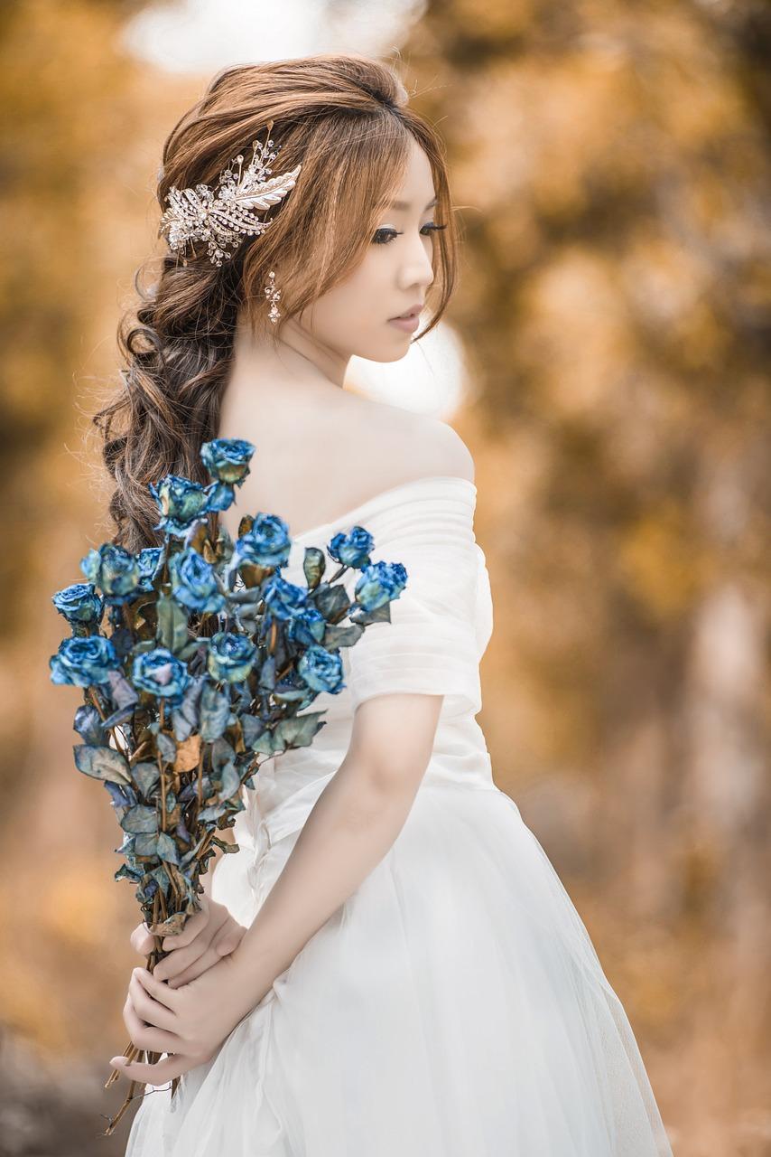 Bride holding a blue bouquet.