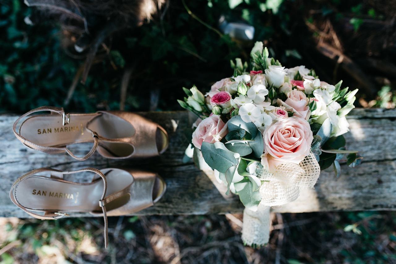 Bride's shoes and bouquet.