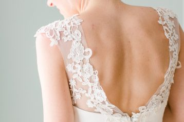 Blonde bride with back to camera.
