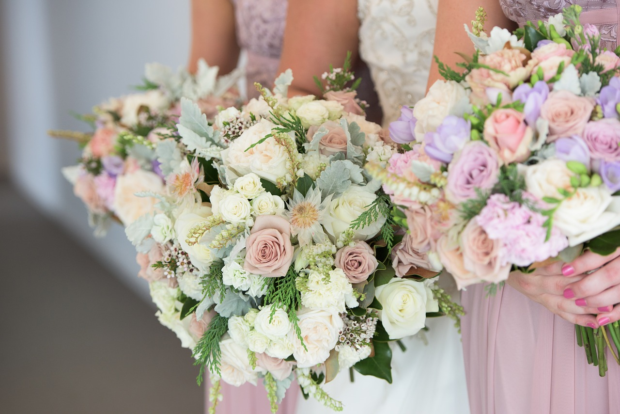 Bridal party holding wedding bouquets.