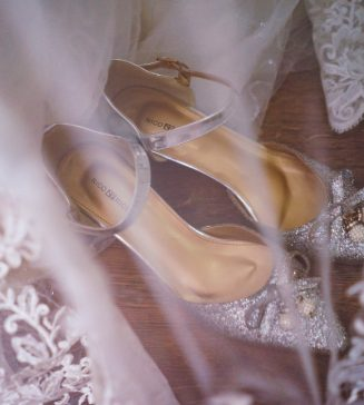 Wedding shoes and the tulle of a wedding gown.
