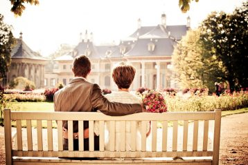 Bride and groom on a bench.