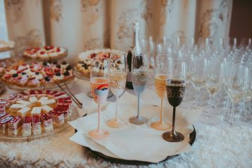 Table of food and drinks at a wedding reception.