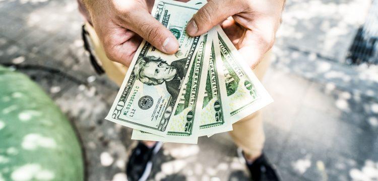 Man holding money.