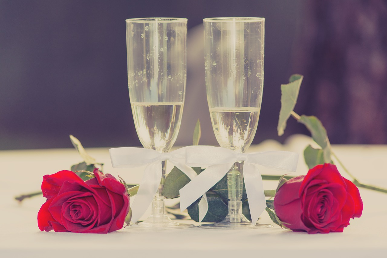 Champagne glasses and red roses.