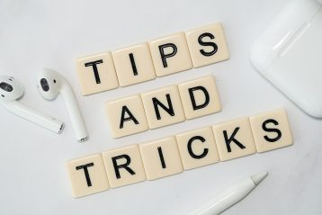 """Scrabble pieces that spell out """"Tips and Tricks""""."""