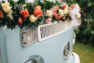 1970s era van with wedding flowers on it.