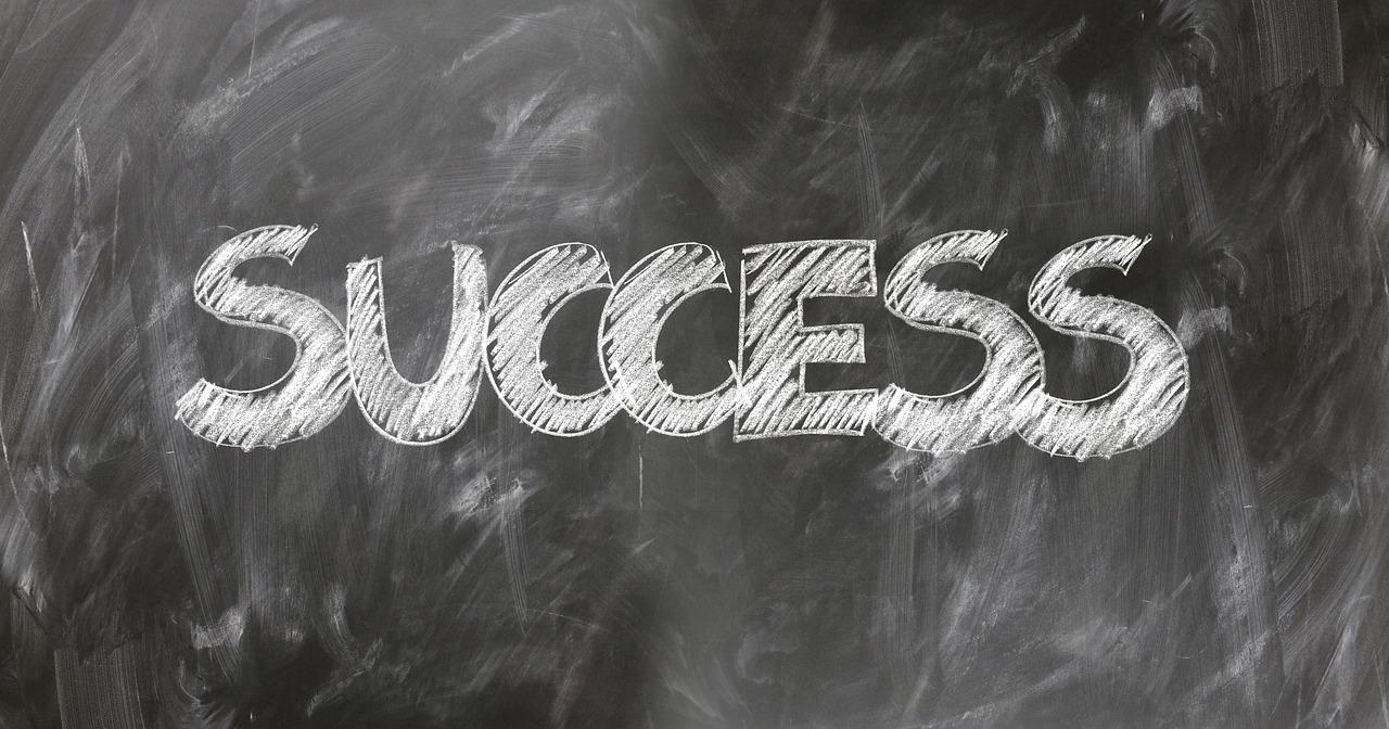 """""""Success"""" written on a chalk board."""