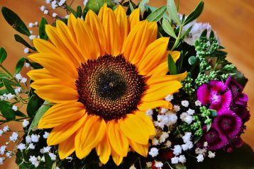 A bouquet with a large sunflower in the center.