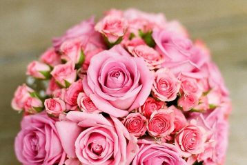 A bouquet of pink wedding flowers.