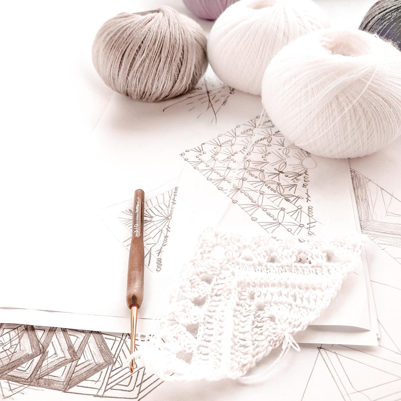 White yarn and knitting needles.