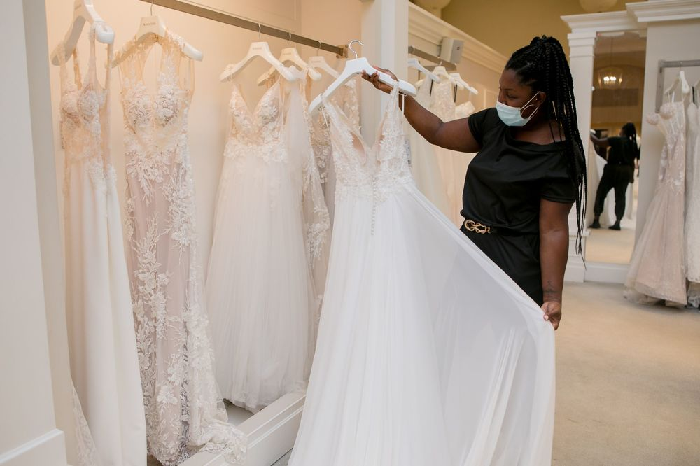 Woman looking at a wedding gown in a dress shop