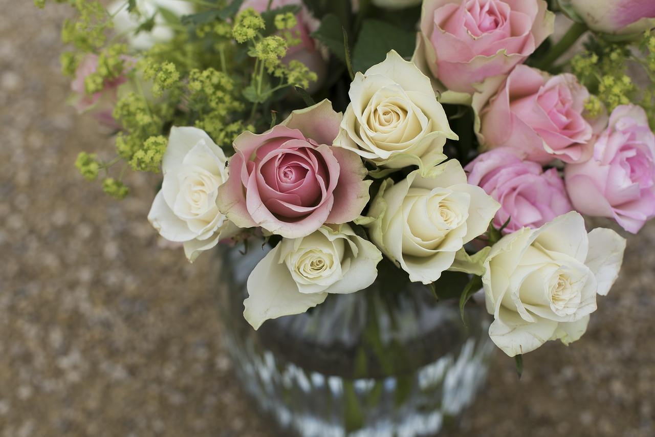 Bouquet of pink and white roses in a vase.
