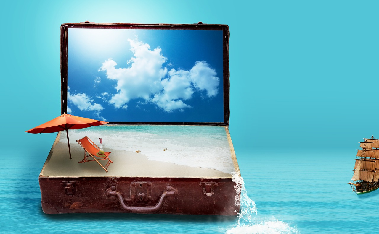 A suitcase with a beach pictured inside of it.