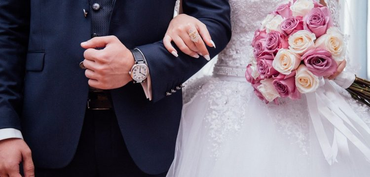 Bride and groom with linked arms.