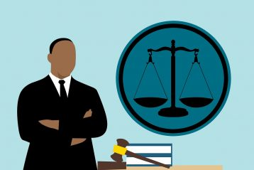 A graphic of a lawyer, scales, and a gavel.