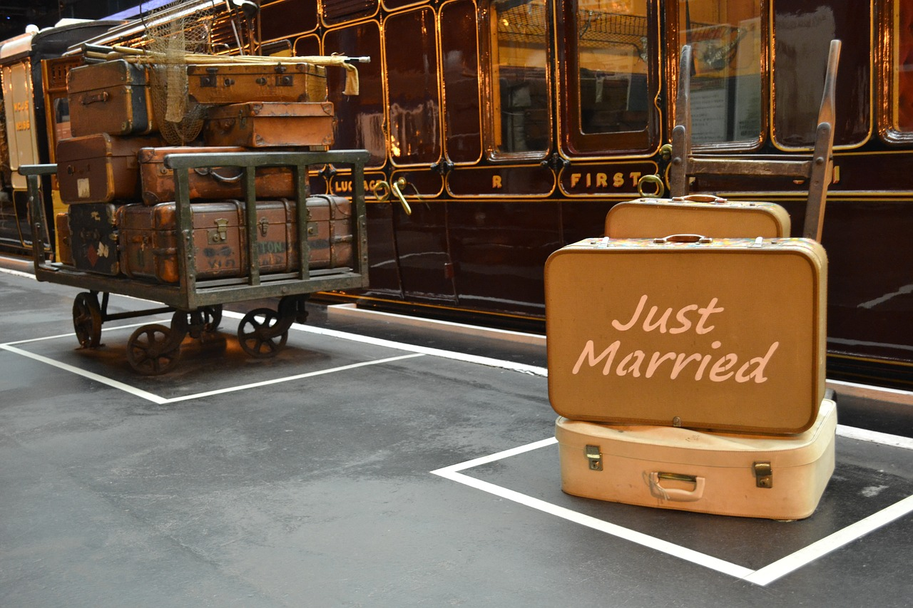 """Luggage with """"Just Married"""" written on it."""