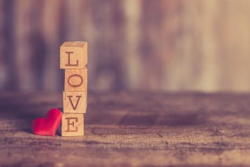 """Letter blocks spelling out the word, """"Love""""."""