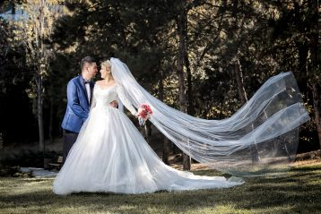 Bride with long veil and groom.