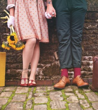 Couple dressed in 1940s style clothing.