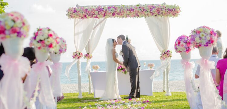 Couple getting married on the beach.