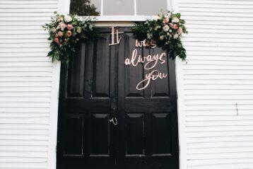 Flower arrangements on church doors.